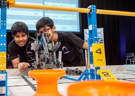 Two young VEX robotics students competing in a VIQC competition.